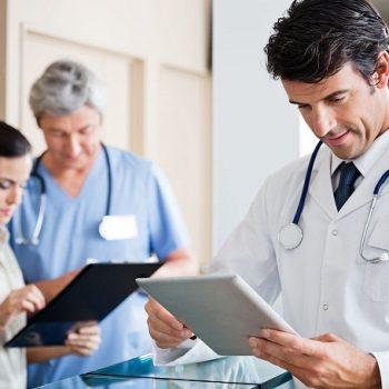 18261262 - male doctor holding digital tablet